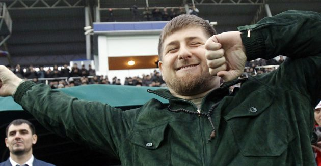 Chechen leader Ramzan Kadyrov (front) performs the Lezginka national dance before a friendly soccer match between team Chechnya and team Brazil, including 1994 and 2002 World Cup champions, in Grozny, March 8, 2011. Kadyrov, leader of Russia's volatile Chechnya region, will play for a Terek Grozny XI in Tuesday's friendly against Brazil's 2002 World Cup winners.  REUTERS/Sergei Karpukhin  (RUSSIA - Tags: SPORT SOCCER POLITICS) - RTR2JMMV